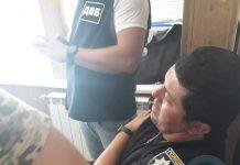 Пойманный на взятке полицейский